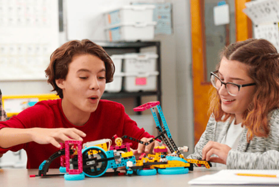 Students learning with Lego Spike robots.