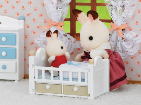 Sylvanian mother in kid's room taking care of her child