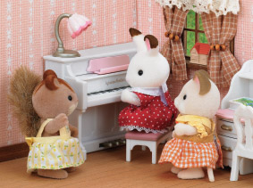 3 Sylvanians in a corner of a room, with one playing piano while the others watch